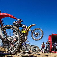 100414       Cable Hoover<br /> <br /> Clayton Willie pops a wheelie as he guns it out of the gate during the Scott Costley Memorial Motocross race Saturday at the Gallup OHV MX Park.