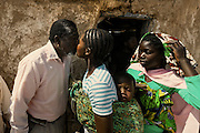 While leaving the local church after the weekly religious works, there is a tradition for the family to greet each other. In Angola?s Namibe desert, at Giraul, in the Namibe province, Tchikuteny, from the Mucubal tribe, is the leader of a big family, maybe the biggest family in the world.<br /> He is the chief leader, the manager and responsible for the entire village. <br /> In his village, Tchikuteny lives nowadays with most of his big family, his 33 wives, that were once 43, but 10 left the village, and most of their descendants.<br /> Tchikuteny maintains the registry of all the new-borns, totalizing 154 sons, and his grandsons, that are around 60. Nowadays, 4 new babies are on the way, and 3 great grand children were born recently.<br /> Huge harmony, love and respect transpire in the village atmosphere. The sense of a community is the pillar of their sustainability and sustenance and their autonomy depends prominently on cattle and agriculture that is made by the villagers. Nevertheless, Tchikuteny village is in close connection with their surrounding communities. Children attend Giraul School and there is proximity and relations with the extended family that lives in the surroundings.<br /> Being the spiritual leader of the community, Tchikuteny is also responsible for the weekly religious works that happens in the village church. <br /> This big family opened his doors to share with us their daily lives.