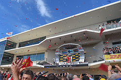 October 21, 2018 - Austin, TX, U.S. - AUSTIN, TX - OCTOBER 21: A wide shot of the fans cheering on the top three finishers as confetti falls following the F1 United States Grand Prix on October 21, 2018, at Circuit of the Americas in Austin, TX. (Photo by Ken Murray/Icon Sportswire) (Credit Image: © Ken Murray/Icon SMI via ZUMA Press)
