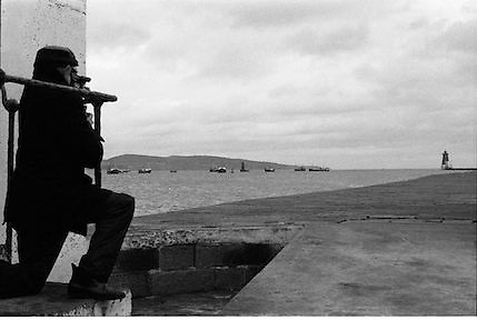 Blockade, Dublin Port by Fishing Trawlers.1982.22.10.1982.10.22.1982.22nd October 1982.As a result of E.U Fisheries policy, in regard to a total ban on herring fishing in the Irish Sea,blockades of eastern fishing ports were started. Several fishermen were imprisioned as a result..A cameraman attempts to capture the unfolding scene..pictures  of ireland.pictures.Photos of Ireland.Photos .old pictures.old photos  of ireland.old photos.old photographs  of ireland.old photographs. images of Ireland.images.historic images  of ireland.historic images.Black and White images of Ireland.