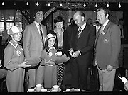 President Hillery at The Community Games..1979..15.09.1979..09.15.1979..15th September 1979..President Patrick Hillery attended the opening of The National Community Games finals at Mosney, Co Meath today. The finals were held in the grounds of The Butlins Holiday Centre and were sponsored by Tayto Irl Ltd,Greencastle Road,Coolock,Dublin..President Hillery pictured being presented with a gold emblem of the games. Included in the photo are Maura Kealy (9),Mr Kevin Masterson,Mrs Laura Masterson, Shiela Masterson (9) and William Walshe.