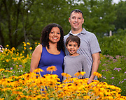 Family photography session at Acton Arboretum. Family standing in front of yellow flowers