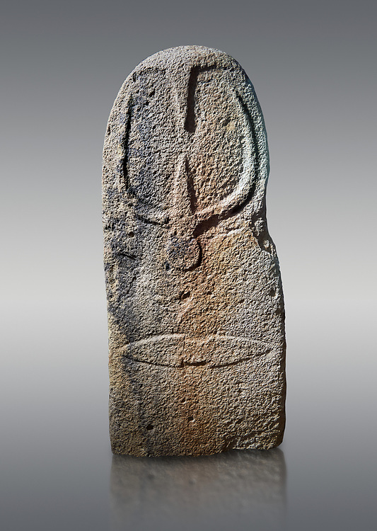Late European Neolithic prehistoric Menhir standing stone with carvings on its face side. The representation of a stylalised male figure starts at the top with a long nose from which 2 eyebrows arch around the top of the stone. below this is a carving of a falling figure with head at the bottom and 2 curved arms encircling a body above. at the bottom is a carving of a dagger running horizontally across the menhir. Excavated from Bau Carradore II, Laconi. Menhir Museum, Museo della Statuaria Prehistorica in Sardegna, Museum of Prehoistoric Sardinian Statues, Palazzo Aymerich, Laconi, Sardinia, Italy. Grey background. .<br /> <br /> Visit our PREHISTORIC PLACES PHOTO COLLECTIONS for more photos to download or buy as prints https://funkystock.photoshelter.com/gallery-collection/Prehistoric-Neolithic-Sites-Art-Artefacts-Pictures-Photos/C0000tfxw63zrUT4