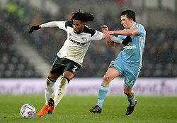 Derby County's Kasey Palmer (left) and Sunderland's George Honeyman battle for the ball