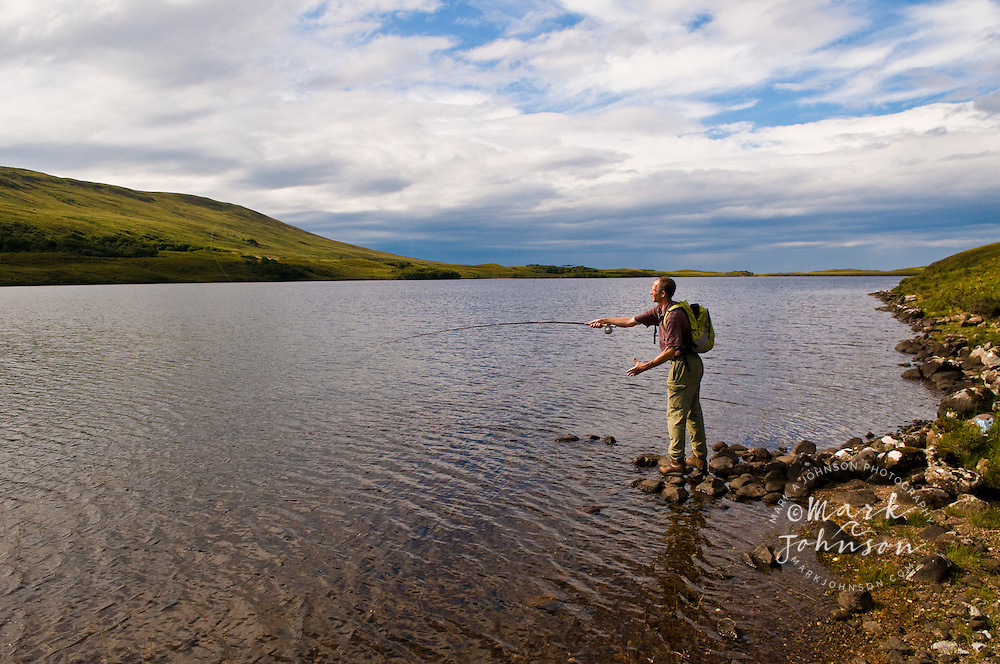 Man flyfishing at Loch An Draing, Western Highlands, Scotland, UK ****Model Release available