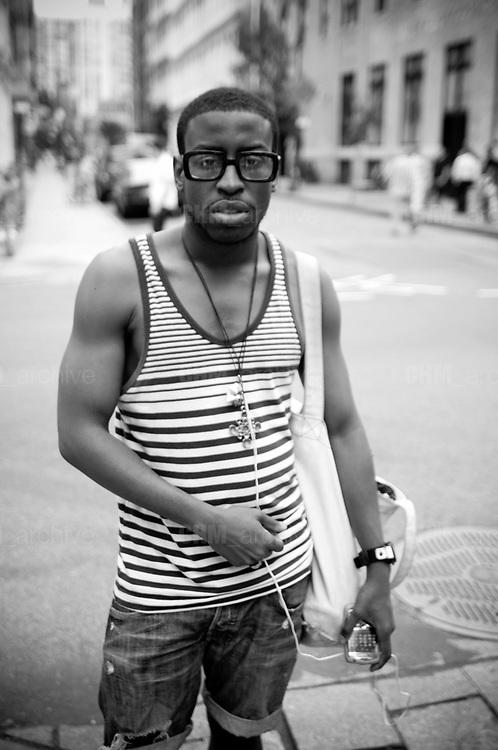 An african american boy in the street, Soho. New York City, 23 june 2010. Christian Mantuano / OneShot