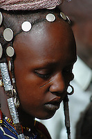 BURKINA FASO, Gorom-Gorom, 2007. Fulani women often carry their wealth with them in the form of jewelry, and are known for their elaborate hairstyles.