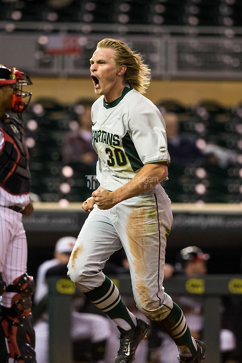 Cam Gibson (30) of the Michigan State Spartans celebrates a run during a 2015 Big Ten Conference Tournament game between the Maryland Terrapins and Michigan State Spartans at Target Field on May 20, 2015 in Minneapolis, Minnesota. (Brace Hemmelgarn)