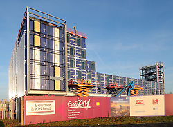 "A Holiday Inn Express Hotel made out of shipping containers has sprung up next to The Trafford Centre in Manchester. The 220 bedroom hotel is shipped as completed shipping containers from China. One builder said ""The rooms come complete with carpets, furniture, curtains already hung, numbers on the doors and the toilet roll is already in its holder."