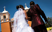 Rosalino leads Sabina to the church before their wedding ceremony. Nick Wagner / Alexia Foundation
