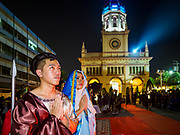 30 MARCH 2018 - BANGKOK, THAILAND: A woman playing Mary Magdelan flanked by Roman soldiers during Good Friday observances at Santa Cruz Church in the Thonburi section of Bangkok. Santa Cruz Church is more than 350 years old and is one of the oldest Catholic churches in Thailand. Good Friday is the day that most Christians observe as the crucifixion of Jesus Christ. Thailand has a small Catholic community.       PHOTO BY JACK KURTZ