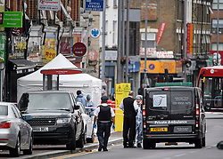 © Licensed to London News Pictures. 07/07/2019. London, UK. A private ambulance and forensics at the scene where a man in his 20s has been shot dead in Leyton, East London in the early hours of this morning. Photo credit: Ben Cawthra/LNP