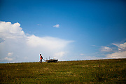 A young man transporting wood across a field in the landscape of eastern Slovakia at the village of Rankovce. The foundation ETP Slovakia has a project setting up micro-loan funds for the local Roma community. Loans from this fund will enable families to build their own low-cost brick homes, on land they own.