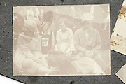 very faded image of women and children sitting in a public garden 1920s