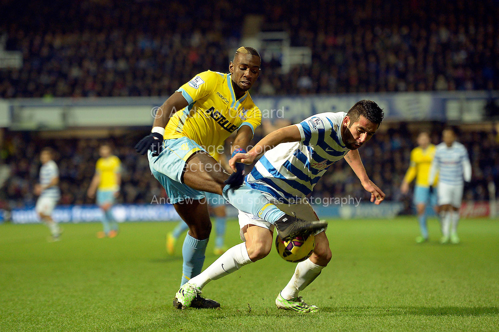 Mauricio Isla of QPR holding the ball from Yannick Bolasie of Crystal Palace. Barclays Premier league match, Queens Park Rangers v Crystal Palace at Loftus Road in London on Sunday 28th December 2014.<br /> pic by John Patrick Fletcher, Andrew Orchard sports photography.
