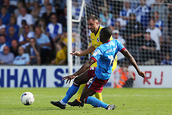 Hakeeb Adelakun of Scunthorpe United tackles Peter Hartley of Bristol Rovers  - Mandatory by-line: Matt McNulty/JMP - 06/08/2016 - FOOTBALL - Glanford Park - Scunthorpe, England - Scunthorpe United v Bristol Rovers - Sky Bet League One