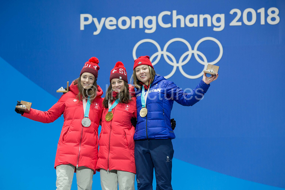 Bronze medalist Isabel Atkin of Great Britain celebrates with Mathilde Gremaud of Switzerland, SILVER and team mate Sarah Hofflin, GOLD, during the medal ceremony for the women's ski slopestyle on day 8 of the PyeongChang 2018 Winter Olympic Games at Medal Plaza on February 17, 2018 in Pyeongchang-gun, South Korea (photo by Sam Mellish / In Pictures via Getty Images)