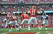KANSAS CITY, MO - DECEMBER 01:  Quarterback Alex Smith #11 of the Kansas City Chiefs drops back to pass against the Denver Broncos during the first half on December 1, 2013 at Arrowhead Stadium in Kansas City, Missouri.  (Photo by Peter Aiken/Getty Images) *** Local Caption *** Alex Smith