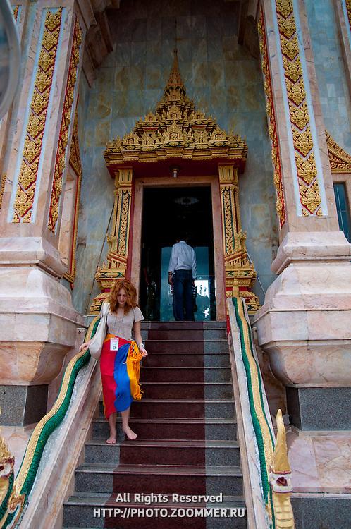Girl inside Wat Chalong buddist temple in Phuket, Thailand