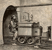 An electric mine locomotive in use on a mine railway at Zaukerode, Saxony, Germany.  This was a push-me-pull-you vehicle which could be driven from either end, so avoiding the necessity of turning the locomotive round. From 'Electricity in the Service of Man' by R. Wormell (London, 1890).