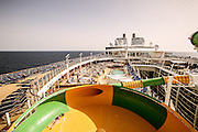 Royal Caribbean, Harmony of the Seas, The Perfect Storm– spiraling five decks above the landscaped, open-air Central Park in the center of the ship, waterslides Cyclone, Typhoon and Supercell come together as The Perfect Storm. Guests can challenge each other and race to the finish line with Cyclone and Typhoon, which twist and turn down three decks, while sliders in Supercell will be swirled around its unique champagne bowl before descending into a big splash finale.