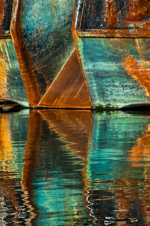 Ships and reflections in the harbor of Newport, Oregon.