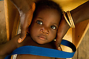 A child lies in a box used to measure height of young children at the Kono government hospital in Koidu, Sierra Leone on Wednesday March 17, 2010.