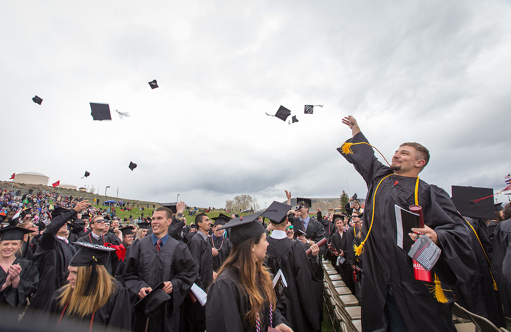 Students cheer and throw their mortar boards at the end of Commencement 2015 at Western State Colorado University.