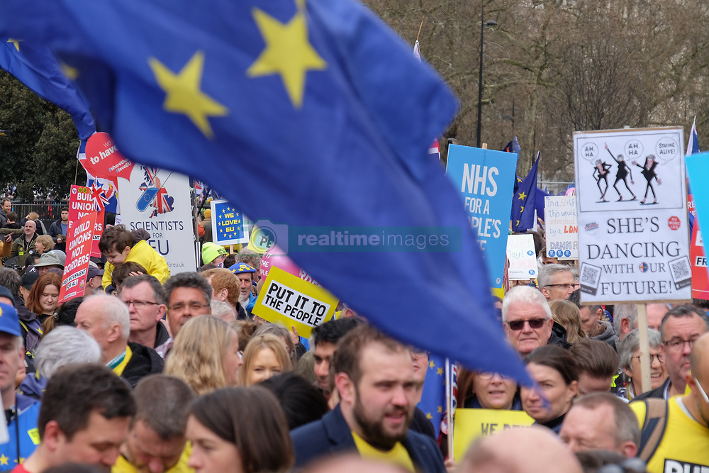 March 23, 2019 - London, England, United Kingdom - A EU flag fly's as protesters gather in central London  on 23 March 2019. Thousands of protesters gathered in central London today to take part in the Put It To The People March. The march from Park Lane to Parliament Square was organised by the Peoples Vote campaign and is calling for a public vote on the Governments final Brexit deal. (Credit Image: © Jay Shaw Baker/NurPhoto via ZUMA Press)