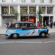 A London Taxi in London City centre advertising the Winter Olympics in Sochi, Russia as London prepares for the  London 2012 Olympic games, UK. 14th July 2012. Photo Tim Clayton