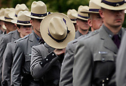 Troopers exit the funeral for New York State Trooper, Joel Davis, at the Magrath Sports Complex at Fort Drum, N.Y., Saturday, July 15, 2017. Trooper Davis, 36, was fatally shot Sunday, July 9, 2017, while responding to reports of gunfire on a couple's property in the town of Theresa, N.Y. <br /> Police say a Fort Drum soldier, Staff Sgt. Justin Walters, fatally shot his 27-year-old wife before shooting Davis. Walters, who served two combat tours in Afghanistan, has been charged with two counts of murder. Fort Drum is the home of the Army's 10th Mountain Division. <br /> (AP Photo/Heather Ainsworth)