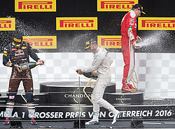 03-07-2016 AUT: Grand Prix van Oostenrijk Formule 1 Red Burg Ring, Spielberg<br /> Podium f.l. 2nd placed Dutch Formula One driver Max Verstappen of Red Bull Racing Race winner British Formula One driver Lewis Hamilton of Mercedes AMG F1 3rd placed Finnish Formula One driver Kimi Raeikkoenen of Scuderia Ferrari during the Race for the Austrian Formula One Grand Prix at the Red Bull Ring in Spielberg<br /> <br /> ***NETHERLANDS ONLY***