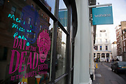 "Day of the Dead promotion in a restaurant window following a suspected outbreak of norovirus, several branches of the Wahaca Mexican food chain were closed after over 350 members of the public and staff fell ill of a probable breakout of the winter vomiting bug, including this branch in Covent Garden in London, United Kingdom. Co-founders Thomasina Miers, and Mark Selby, said: ""We assessed each case and when it became clear they were not isolated incidents, we got in touch with relevant officials at Public Health England and environmental health officers."" In all nine branches were suspected and closed, and four have reopened as of 3rd November 2016."