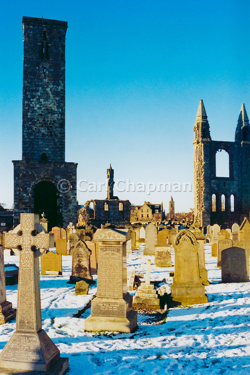 Gravestones in cemetery during snowy winter. St Andrews, Scotland <br /> <br /> Editions:- Open Edition Print / Stock Image