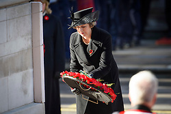Prime Minister Theresa May lays a wreath during the annual Remembrance Sunday Service at the Cenotaph memorial in Whitehall, central London, held in tribute for members of the armed forces who have died in major conflicts. Picture date: Sunday November 13th, 2016. Photo credit should read: Matt Crossick/ EMPICS Entertainment.