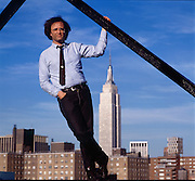 """Joe Dante, movie director, best known for the """"Gremlin"""" movies with Empire State Building in background."""