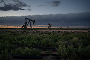 Pump jacks in operation near Loco Hills on April 23, 2020 in Eddy County, New Mexico. Permian Basin crude oil extraction is one of the main economic drivers of this area, and the industry is looking to take a hit as the price of oil dropped to below zero due to decline in demand from the novel coronavirus pandemic.