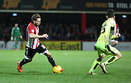 Brentford midfielder Alan Judge wrong footing Huddersfield Town defender Ben Chilwell during the Sky Bet Championship match between Brentford and Huddersfield Town at Griffin Park, London, England on 19 December 2015. Photo by Matthew Redman.