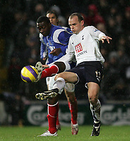 Photo: Lee Earle.<br /> Portsmouth v Tottenham Hotspur. The Barclays Premiership. 01/01/2007.Portsmouth's Andrew Cole (L) battles with Danny Murphy.
