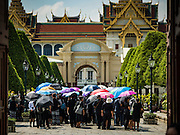 14 OCTOBER 2016 - BANGKOK, THAILAND: A group of people enter the Grand Palace in Bangkok to pay respects to Bhumibol Adulyadej, the King of Thailand, who died Oct. 13, 2016. He was 88. His death comes after a period of failing health. With the king's death, the world's longest-reigning monarch is Queen Elizabeth II, who ascended to the British throne in 1952. Bhumibol Adulyadej, was born in Cambridge, MA, on 5 December 1927. He was the ninth monarch of Thailand from the Chakri Dynasty and is known as Rama IX. He became King on June 9, 1946 and served as King of Thailand for 70 years, 126 days. He was, at the time of his death, the world's longest-serving head of state and the longest-reigning monarch in Thai history.     PHOTO BY JACK KURTZ