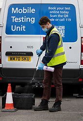 © Licensed to London News Pictures. 19/06/2021. Tattenham Corner, UK. Equipment is sanitised at a mobile covid-19 test centre at Tattenham Corner, Surrey. Surge testing for the coronavirus is taking place in parts of Surrey after a rise in infections caused by the delta variant. Photo credit: Peter Macdiarmid/LNP
