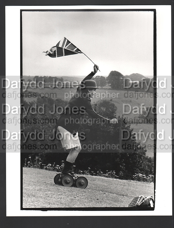 Crispin Balfour rolling along at the Dangerous Sports Club Tea party. Given at the Gloucestershire home of the Dutch Ambassador Robbert Fack. 22 August 1981Exhibition in a Box