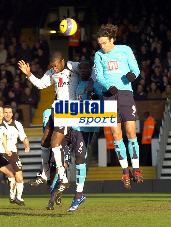 Photo: Olly Greenwood.<br />Fulham v Tottenham Hotspur. The Barclays Premiership. 20/01/2007. Tottenham's Dimitar Berbatov and Pascal Chimbonda jump for the ball with Fulham's Phillippe Christanval