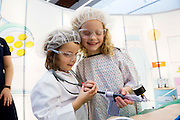 27/11/2016 REPRO FREE:  Carmen Hodgson (5) and her sister Talia Hodgson (7) from St. Nicholas N.S., Claddagh and originally from Nee York,enjoythe Medtronic exhibitioninNUI Galway as part of the Galway Science & Technology Festival. Photo: Andrew Downes, Xposure.