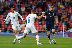 Scotland's Stuart Armstrong (right) and Czech Republic's Vladimir Coufal (centre) battle for the ball during the UEFA Euro 2020 Group D match at Hampden Park, Glasgow. Picture date: Monday June 14, 2021.