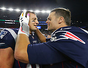 Patriots quarterback Tom Brady (left) celebrates with tight end Rob Gronkowski postgame following the Patriots 43-40 win over the previously undefeated Chiefs in the Patirots game against Kansas City on Sunday, Oct. 14, 2018 in Foxboro. Eric J. Adler [New England Patriots] via AP Images