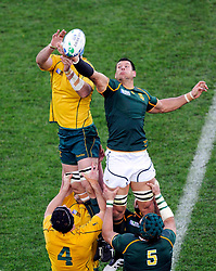 South Africa Springboks' Pierre Spies (R) takes a line out from Australia Wallabies captain James Horwill during their Rugby World Cup quarter-final match at Wellington Regional Stadium October 9, 2011. REUTERS/Anthony Phelps (NEW ZEALAND  - Tags: SPORT RUGBY)