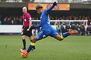 AFC Wimbledon striker Lyle Taylor (33) with a shot on goal during the EFL Sky Bet League 1 match between AFC Wimbledon and Blackpool at the Cherry Red Records Stadium, Kingston, England on 20 January 2018. Photo by Matthew Redman.