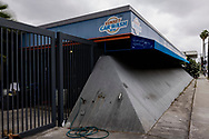 The Sunset Car Wash has been closed since late February 2020. The concrete bunker-like car wash built in 1972 has cleaned some of the world's most amazing automobiles. Celebrities and locals favored the wash due to its proximity to the Sunset Strip.<br /> The business appears to be shutdown, homeless people and graffiti have overtaken the property.