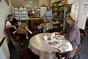 A group of regular customers chat with one another at Caffi Trefermy on the 20th April 2011 in Corwen in the United Kingdom.